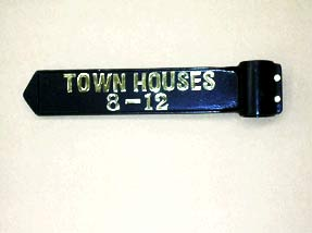 A cast metal sign for town house development.